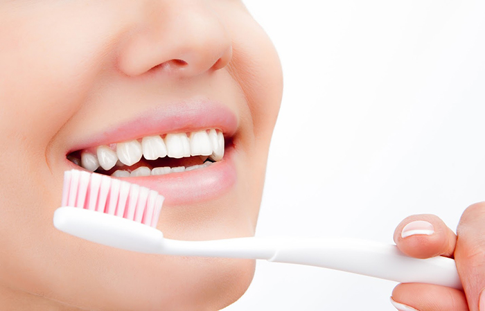 Young smileing woman with brushing teeth. Dental health background.